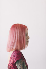young woman with pink hair