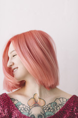 happy young woman with pink hair