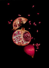 Pomegranate in a black background