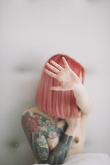 young woman with pink hair hide