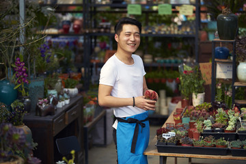 one young male florist working in the shop