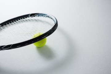 Cropped image of racket with tennis ball