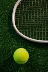 Cropped image of racket by tennis ball