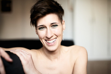 Short haired smiling woman looking at camera