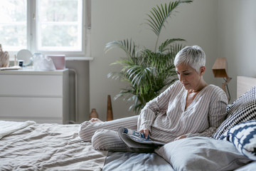 Woman Reading a Magazine in the Morning