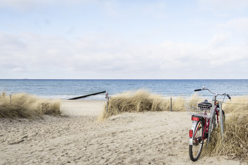 Bicycle parked in dunes near the sea