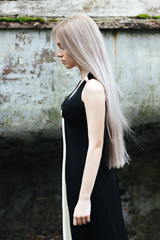 Portrait of a beautiful female model with long pastel hair