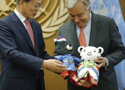 South Korean President Moon Jae-in and United Nations Secretary General Guterres hold stuffed animals prior to their meeting at U.N. headquarters in New York