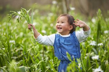 happy little asian girl in spring field