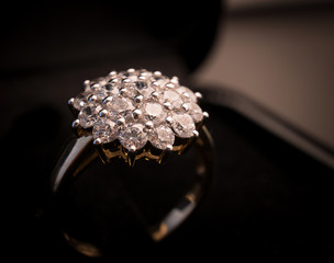 Jewel gemstone ring on black background