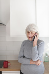 senior woman using talkiing on her mobile phone