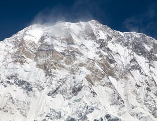 View of Mount Annapurna with group of climbers