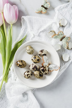Quail eggs with tulips and butterflies