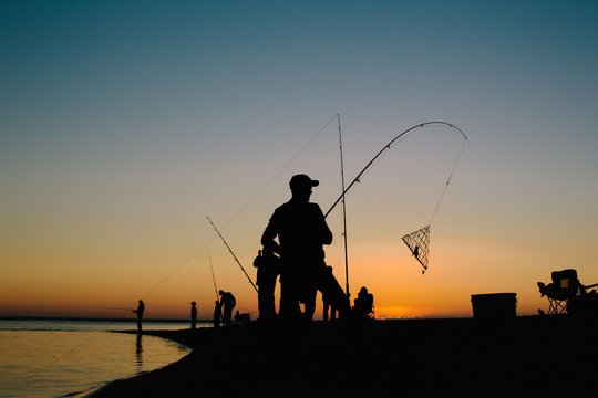 people crabbing at sunset