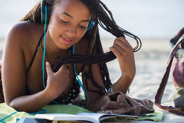 Young Black Woman Reading at the Beach