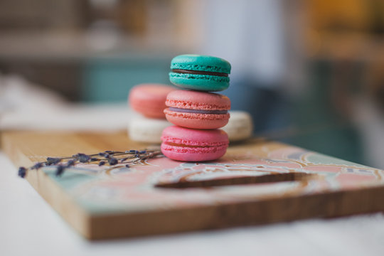 Macaroons on the painted cutting board
