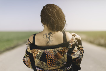 tattoo on the back black woman