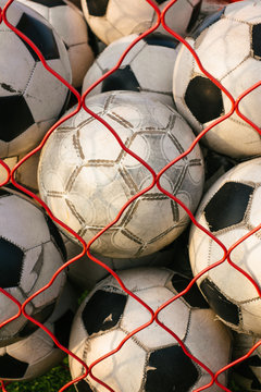 Net full of footballs
