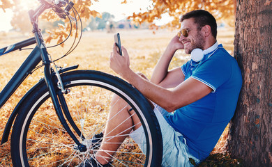 Man with bicycle. Resting after a bike ride. Lifestyle, sport, recreation concept