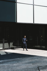 Businessman walking in the corporate area