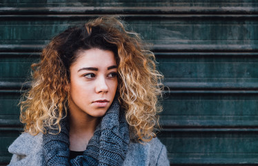 Portrait of Beautiful Young Woman With Curly Hair