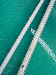 Boat traveling under the Seven Mile Bridge, Florida Keys, USA