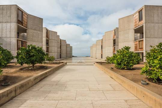 Symmetrical architecture of the Salk Institute in San Diego with orange citrus trees