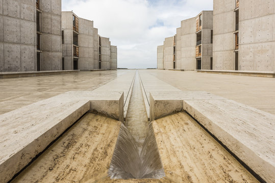 Symmetrical architecture of the Salk Institute in San Diego with fountain vanishing point