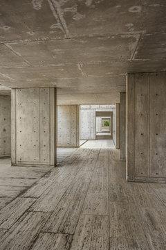 Cement modern urban architecture of the Salk Institute in San Diego with dark passageway tunnel