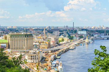 Aerial view of Kiev, Ukraine and Dnieper river with construction of buildings