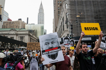 "The Chrysler building is seen in the background as activists take part in the ""Rise and Resist Against White Supremacy"" march in Manhattan, New York"