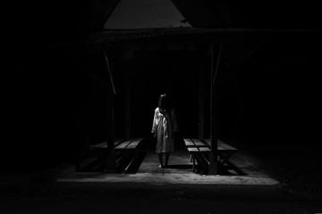 Mysterious Woman, Horror scene of scary ghost woman standing outdoor on Thai style old pavillion with light in white tone