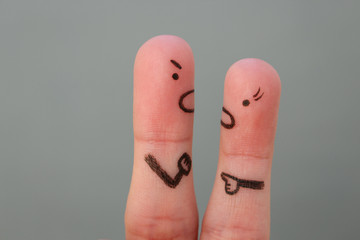 Fingers art of couple in quarrel. Man and woman swear.