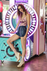 Street style fashion at the arcade. Crushed velvet tank top, bluish leather pants and platform heals.