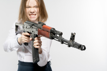 The girl with an aggressive look with a Kalashnikov in his hand. Isolated