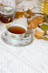 tea, cinnamon, apples, honey and star anise on a white background