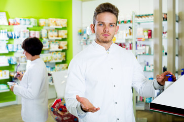 Glad man druggist in white coat