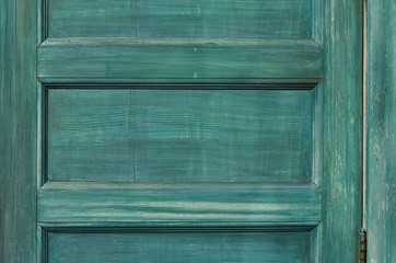 Close-up detail of an old colored wooden door with space for text