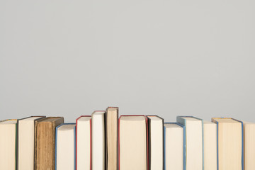 Row of books on a gray background with space for copy