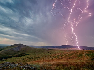 Thunderstorm with lightnings over the fields