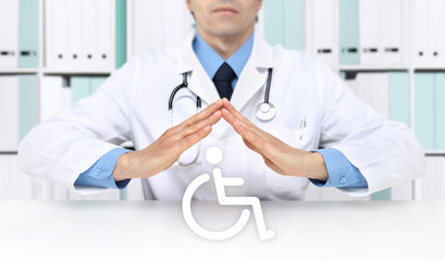 hands doctor protect wheelchair symbol