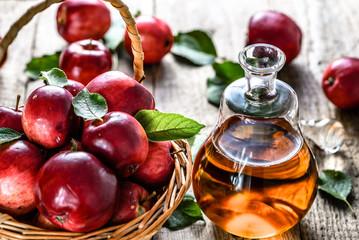 Apple vinegar or cider, bottle of drink and apples, healthy organic food concept