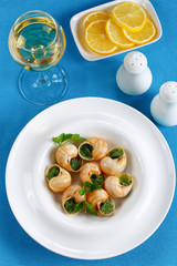 portion of Snails with herbs, butter