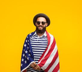 Man posing in American flag