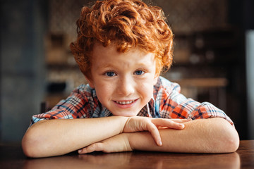 Adorable redhead boy smiling into camera