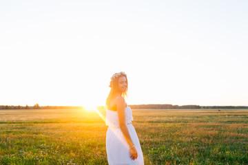 Romantic woman in green field