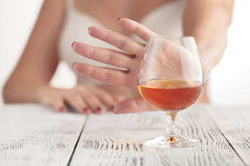 woman refused a glass of wiskey