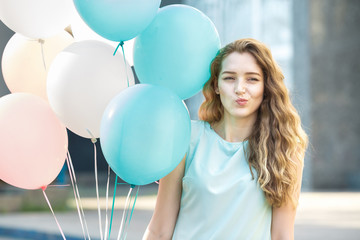 beautiful woman with flying multicolored balloons