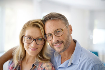 Portrait of mature couple wearing eyeglasses