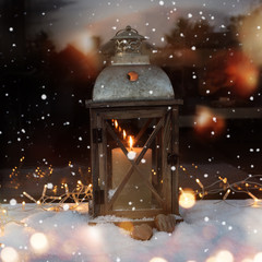 Winter still life with a lantern